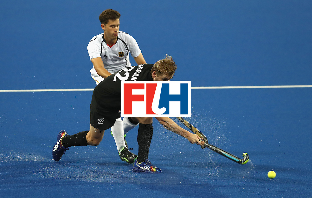 RIO DE JANEIRO, BRAZIL - AUGUST 14:  Blair Tarrant of New Zealand passes the ball during the Men's hockey quarter final match between the Germany and New Zealand on Day 9 of the Rio 2016 Olympic Games at the Olympic Hockey Centre on August 14, 2016 in Rio de Janeiro, Brazil.  (Photo by David Rogers/Getty Images)