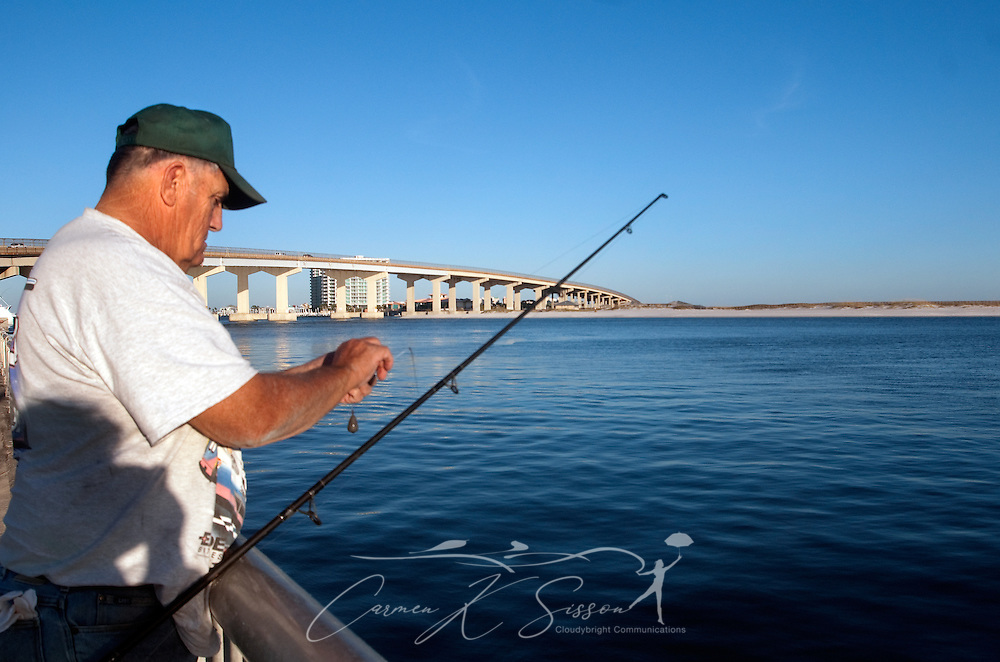 John Putnam baits his hook at Florida Point fishing pier Nov. 12, 2009 in Orange Beach, Ala. (Photo by Carmen K. Sisson/Cloudybright)