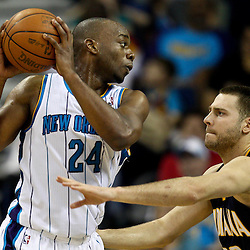 April 3, 2011; New Orleans, LA, USA; New Orleans Hornets power forward Carl Landry (24) is guarded by Indiana Pacers power forward Josh McRoberts (32) during the fourth quarter at the New Orleans Arena. The Hornets defeated the Pacers 108-96.  Mandatory Credit: Derick E. Hingle