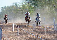 Young Boys Horse Racing. Matto Grosso, Brazil, Isobel Springett