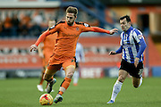 Wolverhampton Wanderers midfielder James Henry  with a shot watched by Sheffield Wednesday midfielder Ross Wallace  during the Sky Bet Championship match between Sheffield Wednesday and Wolverhampton Wanderers at Hillsborough, Sheffield, England on 20 December 2015. Photo by Simon Davies.