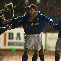 Ayr Utd v St Johnstone...13.12.03<br />Paul Bernard celebrates his goal with the St Johnstone fans and Peter MacDonald and Simon Donnelly<br /><br />Picture by Graeme Hart.<br />Copyright Perthshire Picture Agency<br />Tel: 01738 623350  Mobile: 07990 594431