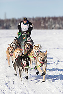 Musher Scott Janssen after the restart in Willow of the 46th Iditarod Trail Sled Dog Race in Southcentral Alaska.  Afternoon. Winter.