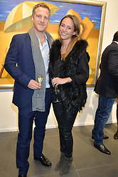 JAMIE RICHARDS and LAVINIA BRENNAN at a private view of works by Fernando Botero held at the Opera Gallery London, 134 New Bond Street, London on 10th February 2015.