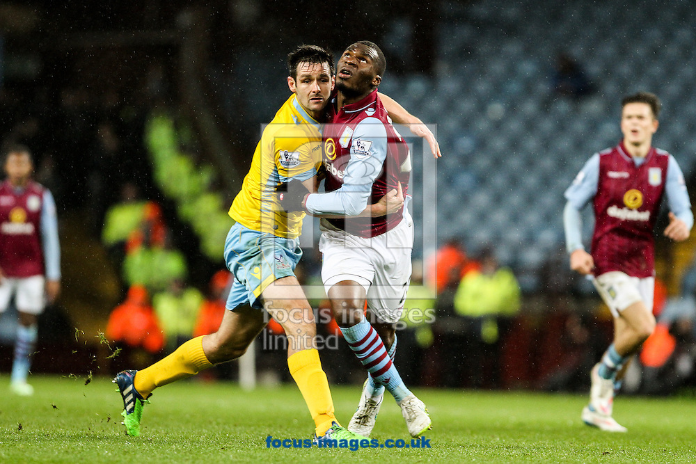 Scott Dann of Crystal Palace (left) competing with Christian Benteke of Aston Villa (right) during the Barclays Premier League match at Villa Park, Birmingham<br /> Picture by Andy Kearns/Focus Images Ltd 0781 864 4264<br /> 01/01/2015
