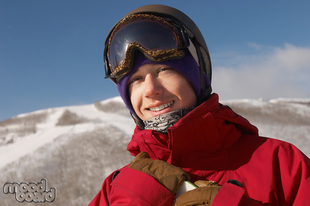 Portrait of young snowboarder smiling