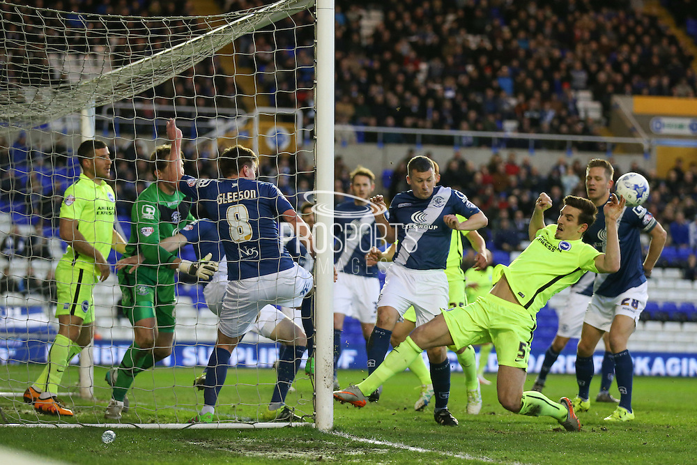 Goal mouth scramble  during the Sky Bet Championship match between Birmingham City and Brighton and Hove Albion at St Andrews, Birmingham, England on 5 April 2016. Photo by Simon Davies.