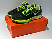 Detailed view of Nike Air Zoom Vomero 10 running shoes in volt/white, black and electric green colorway. The shoes feature Flywire technology, mesh fabric and Zoom Air units.
