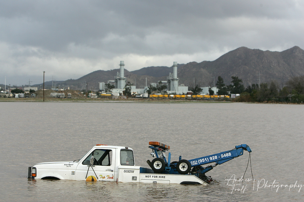 A tow truck rests in a lake of water after being overcome by a deluge on Encanto Rd in Sun City Thursday afternoon.