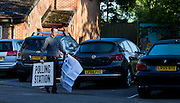 UNITED KINGDOM, London: 7 May 2015,  A Polling station member is photographed setting up signs in Richmond as polling starts for the 2015 Election, London, England. Andrew Cowie / Story Picture Agency