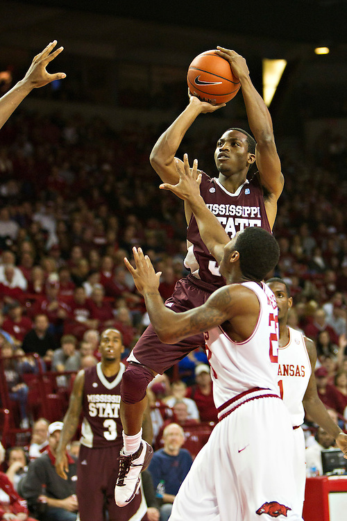 FAYETTEVILLE, AR - JANUARY 7:    DeVille Smith #33 of the Mississippi State Bulldogs shots the ball against the Arkansas Razorbacks at Bud Walton Arena on January 7, 2012 in Fayetteville, Arkansas.  The Razorbacks defeated the Bulldogs 98-88.  (Photo by Wesley Hitt/Getty Images) *** Local Caption *** DeVille Smith