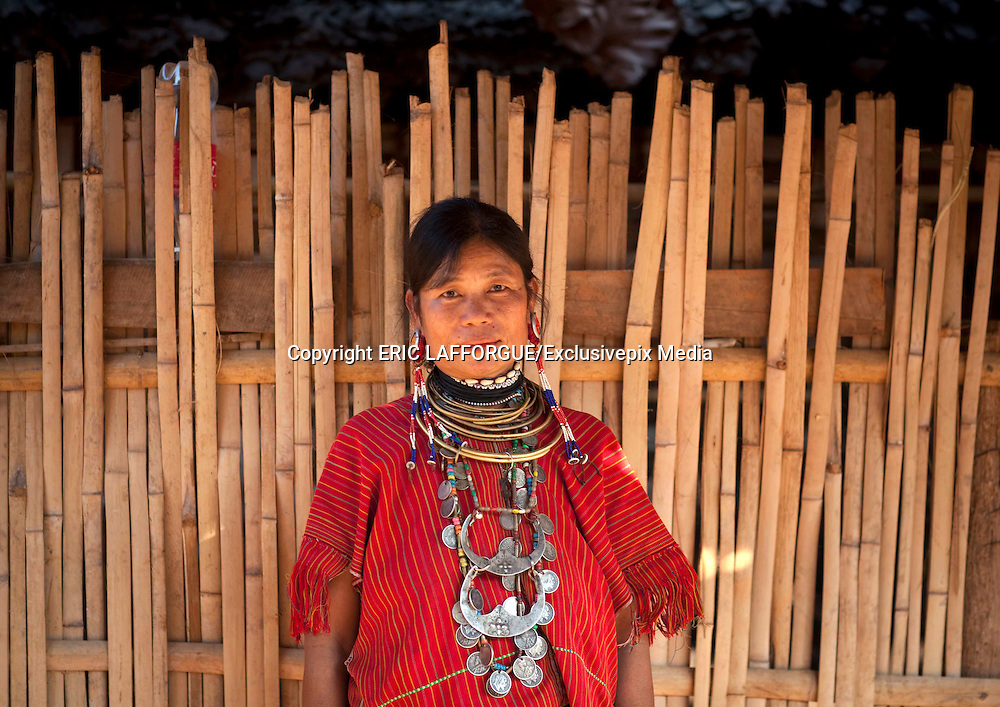 NORTH THAILAND LAST TRIBES <br /> <br /> Most  of  the  people  think  Thailand  hosts  only  one  tribe,  the  vey  famous  long  neck.  Much more  tribes  still  live  in  the  north  of  the  country  with  strong  traditions.  To  reach  them  by road, you'll  need to like curves : thousands are waiting for you in the hills ! Kor Yor tribe (Kayaw), aka the Big Ears or Long Ears, are of of them. They are called like this as they wear since their youngest age some huge ear rings. Like the Long Necks, they are Karenni refugees from Myanmar. Most of the ones i met are christians,  and  wear  some  Jesus  cross  around  the  neck.  They  are  different  from  the  long Neck  women,  as  they  have  their  own  language  and  traditions.  In  Thailand,  like  the  Long Necks,  they  can  be  seen  in  tourists  villages  that  she  share.  Some  critisize  those  touristic villages but many women told me that thanbks to the tourists they could leave the refugee camp , earn money , and get a better life than just waiting for international aid in the camp.   Lahu  people  live  in  the  mountains  of  China,  Myanmar,  Laos  and  northern  Thailand.The Lahu  people  are  famous  for  their  musical  instruments,  made of  wood  and  bamboo.  Uncle Ja  Yo,  a  famous  musician,    told  me  that  when  he  was  young,  he  used  his  Nor  Ku  Ma  to seduce the girls from the others villages,  playing loud to attire them all a round the valley ! There  are  approximately  30  000  Lahus  now  living  in  Thailand. There  are  four  tribes  within the Lahu: Black, Red, Yellow and She-Leh. I met the Black ones, called like that because of the  black  colors  of  the  women  traditional  clothes  sleeves.  Before,  their  domestic  animals like  chickens,  pigs  and  buffalos  were  kept  in  the  basement  corral  of  their  houses,  but  thai goverment has asked them to separate for health security. So now, you can find 2 villages : one  for  the  humans,  one  for  the  animals  !