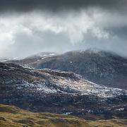 Light reflecting off the rock of Beinn an Fhurain, Sutherland