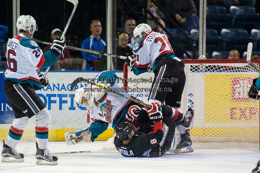 KELOWNA, CANADA - SEPTEMBER 5: Chase Witala #8 of Prince George Cougars slides into Jackson Whistle #1 of Kelowna Rockets on September 5, 2015 during the first pre-season game at Prospera Place in Kelowna, British Columbia, Canada.  (Photo by Marissa Baecker/Shoot the Breeze)  *** Local Caption *** Jackson Whistle; Chase Witala;