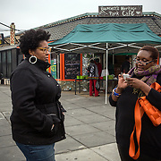 WASHINGTON, DC - NOV 16 :  Kimberly Gaines (L) and Seshat Walker (Right), community organizers who are profiling interesting people in their Deanwood neighborhood, stand outside the Riverside Center, November 16, 2013, in Deanwood, Washington, DC. Their project is called My Deanwood, and they photograph community members and write stories about them. (Photo by Evelyn Hockstein/For The Washington Post)