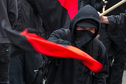 © Licensed to London News Pictures . FILE PHOTO DATED 26/03/2011 of a Black Bloc of protesters at a demonstration in London as reports circulate that black bloc tactics may be employed by protesters seeking to demonstrate during the funeral of former British Prime Minister Margaret Thatcher . Photo credit : Joel Goodman/LNP