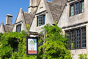 Pub sign of the Bay Tree Hotel a traditional old gastro pub hotel with leaded light windows in Burford, The Cotswolds, Oxfordshire, UK