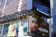 September 11 2001. Times Square poster for the new Schwarzenegger movie with in the background the news concerning the World Trade Center disaster.