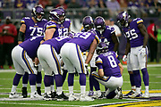 The Minnesota Vikings offense huddles and calls a play during the NFL week 6 regular season football game against the Arizona Cardinals on Sunday, Oct. 14, 2018 in Minneapolis. The Vikings won the game 27-17. (©Paul Anthony Spinelli)