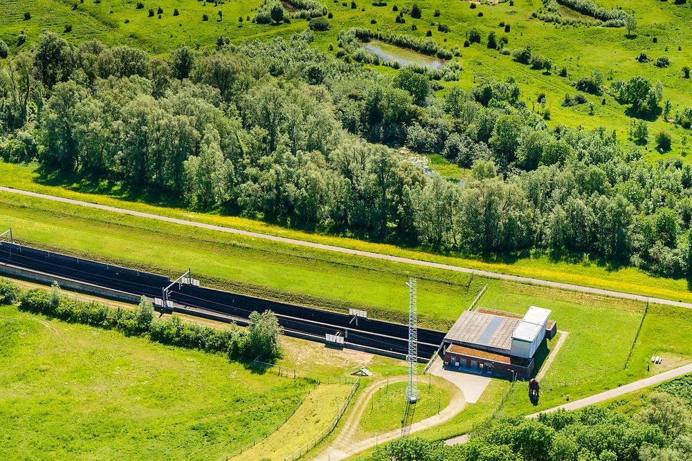 Nederland, Gelderland, Duiven, 29-05-2019; Groessen, natuurgebied Kandia. Betuweroute met dienstgebouw van de tunnel onder het Pannerdensch kanaal (Neder-Rijn). Tunnel Betuweroute, freight railway, Pannerdensch channel (Lower Rhine).<br /> luchtfoto (toeslag op standard tarieven);<br /> aerial photo (additional fee required);<br /> copyright foto/photo Siebe Swart