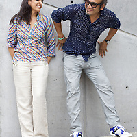 "Contemporary artist husband-and-wife Subodh Gupta and Bharti Kher in Gupta's recently completed studio in the Delhi-satalite town of Gurgaon...Gupta's most celebrated sculptures are constructed from common domestic items including the steel pots and pans that are a feature every Indian home. Of the kitchen-ware that forms the basis of his work, Gupta says,..""The poor, the middle class and the rich use it at home. In this country, how many people have the utensils but they starve because there is no food?""..Gupta was brought up, one of six children, to a railway-worker father in a north Indian village. ..Gupta's work fetches such huge sums of money. Two versions of his Mind Shut Down, modeled on the human skull and constructed entirely of steel kitchen utensils recently sold for EUR1 million each...Photo: Tom Pietrasik.Gurgaon, Haryana. India. .July 23rd 2009"