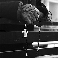 DONGLU, 11, MARCH 2001: an elderly woman carries a rosary during massChina cut relations with the Vatican in the early fifites and since then, established a Patriotic catholic Church that's controlled by Chinese authorities.<br />