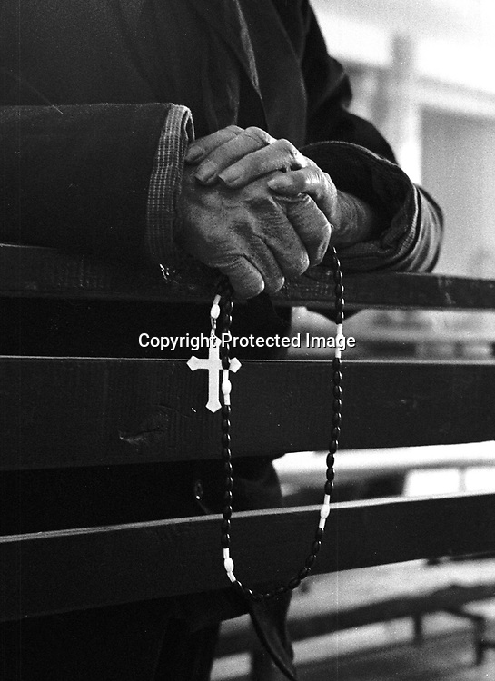 DONGLU, 11, MARCH 2001: an elderly woman carries a rosary during massChina cut relations with the Vatican in the early fifites and since then, established a Patriotic catholic Church that's controlled by Chinese authorities.<br />Catholics who refused to give up their ties with the Vatican, started worshipping in underground churches and consequently were persecuted for a long time. Since the late nineties though, relations with the Vatican informally started to improve. Although China still has no diplomatic relations, many representatives from official churches met the pope John Paull II secretely . The Vatican, under the pope's leadership, has made several efforts to recover the tie with China. In February 2006 , Hong Kong Bishop Joseph Zen was named one of the first 15 new cardinals, which is seen by many as a gesture of goodwill and a significant step towards recovering the Vatican-China relationship