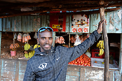 © Licensed to London News Pictures. Iten, Kenya. Double world and Olympic champion MO FARAH poses for a photograph at a local shop during training at an altitude training camp based at 2,500m in Iten, Kenya, ahead of the 2014 Virgin Money London Marathon in April this year. The Somalia born, adopted Brit, is looking to make the jump from the 10,000m distance to a full marathon for the first time in front of a home crowd. Photo credit : Mike King/LNP