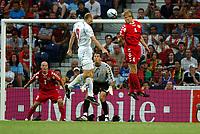 Jan Koller Czech Republic scores goal past<br />Martin Laursen Denmark<br />Czech Republic V Denmark 27/06/04 Quarter Finals  <br />EURO 2004 PORTUGAL<br />Photo Robin Parker Fotosports International