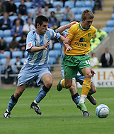 Coventry - Saturday August 9th, 2008: Arturo Lupoli of Norwich City and Scott Dan of Coventry City during the Coca Cola Championship match at The Ricoh Arena, Coventry. (Pic by Michael Sedgwick/Focus Images)