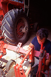 Farmer Repairing Tractor Agriculture