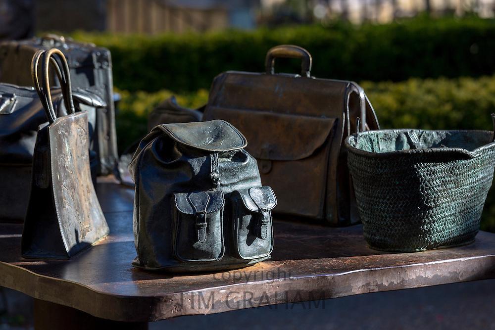 "Bronze table-top sculptures of bags by Koko Rico titled ""Viajeros/Bidaiariak Izenekoa"" at Laguardia in Rioja-Alavesa, Spain"