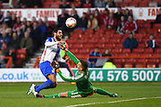 Blackburn Rovers Forward Danny Graham (12) scores after contact with Nottingham Forest goalkeeper Dorus de Vries (1) during the Sky Bet Championship match between Nottingham Forest and Blackburn Rovers at the City Ground, Nottingham, England on 19 April 2016. Photo by Jon Hobley.