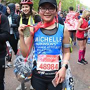 London, England, UK. 28 April 2019. Xiao Mo Xu from China finish the Virgin Money London Marathon at Pall Mall.