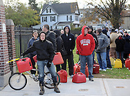 People wait in line for National Guard troops to dispense gasoline from a Department of Defense truck after President Obama authorized the move as the city tries to recover from the after effects of Hurricane Sandy in Staten Island, New York, USA, 03 November 2012. Power shortages and breaks in the supply chain have created a massive shortage of gasoline in New York and New Jersey.