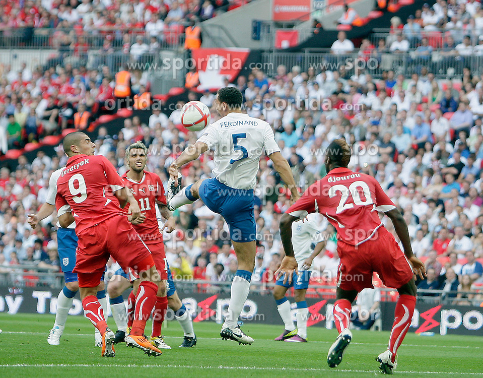04.06.2011, Wembley Stadium, London, ENG, UEFA EURO 2012, Qualifikation, England vs Switzerland, im Bild Rio Ferdinand of England  fails to clear a floating free kick from Tranquillo Barnetta of Switzerland for the first Swiss Goal  during England vs Switzerland  for the UEFA 2012  Group G at the Wembley Stadium  in London    on 04/06/2011. EXPA Pictures © 2011, PhotoCredit: EXPA/ IPS/ Marcello Pozzetti +++++ ATTENTION - OUT OF ENGLAND/UK and FRANCE/FR +++++