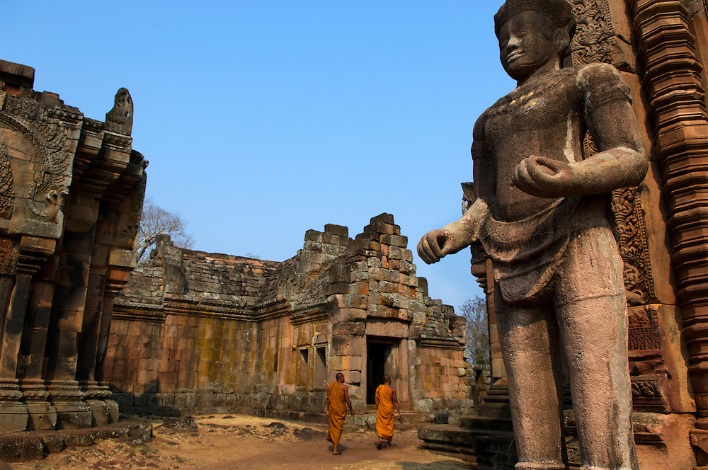Two monks explore the Khmer ruins of Prasat Phanom Rung.