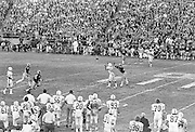 COLLEGE FOOTBALL:  Stanford running back Jackie Brown receives a pass during the 1972 Rose Bowl against Michigan played on January 1, 1972 at the Rose Bowl in Pasadena, California. Stanford won by a score of 13-12.  Other players visible include Stanford's Miles Moore #45 and John Winesberry #26.  BW R0148-16