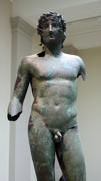 Bronze statue of a young man. In ancient Greece and Rome, bronze and marble statues adorned public places and the sanctuaries of the gods.  Over the centuries almost all the bronze statues were melted down for re-use.  This is one of the very few surviving examples, found in Egypt.  The figure is a Roman version of an earlier Greek statue.