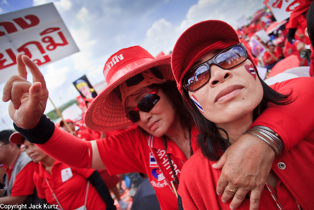 "26 MARCH 2009 -- BANGKOK, THAILAND: Supporters of exiled former Thai Prime Minister Thaksin Shinawatra demonstrate in favor of his return in Bangkok. More than 30,000 members of the United Front of Democracy Against Dictatorship (UDD), also known as the ""Red Shirts""  and their supporters gathered on Sanam Luang (the vast open field in front of the Palace) and descended on central Bangkok March 26 to start a series of protests against and demand the resignation of current Thai Prime Minister Abhisit Vejjajiva and his government. The protest is a continuation of protests the Red Shirts have been holding across Thailand. Thaksin was deposed in a coup and went into exile rather than go to prison after being convicted on corruption charges. He is still enormously popular in rural Thailand.   PHOTO BY JACK KURTZ"