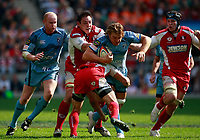 Photo: Richard Lane/Richard Lane Photography. Gloucester Rugby v Cardiff Blues. Anglo Welsh EDF Energy Cup Final. 18/04/2009. Blues' Andy Powell is tackled by Gloucester's Gareth Delve.