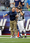 New England Patriots Head Coach Bill Belichick screams at a sideline official during the NFL regular season week 3 football game against the Buffalo Bills on September 26, 2010 in Foxborough, Massachusetts. The Patriots won the game 38-30. (©Paul Anthony Spinelli)