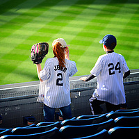 A young boy and a girl anxiously waiting for the start of a baseball game in Yankee Stadium Bronx, New York City.