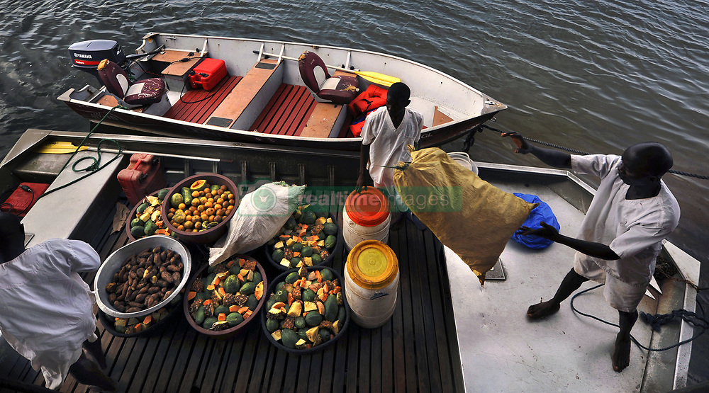 March 3, 2016 - Charlesville, Liberia - Liberian Chimpanzee Rescue caregivers load boat with their food at the dock on March 3, 2016 in Liberia, West Africa.  Foraging for the food takes a great deal of time.  The Humane Society of the United States and New York Blood Center came to an agreement recently in May 2017 after years of discussion about the care of research chimps that were abandoned by NYBC which withdrew all funding for food and water after decades of biomedical experimentation.  Their former caregivers used their own meager finances to continue feeding them. The Humane Society of the United States stepped in to improve the dire situation in which the chimps were literally left to die if not for the heroic efforts of their caregivers, former employees of NYBC who were abandoned as well. The chimps now live on six mangrove islands until funding can be provided for a true sanctuary. (Credit Image: © Carol Guzy via ZUMA Wire)