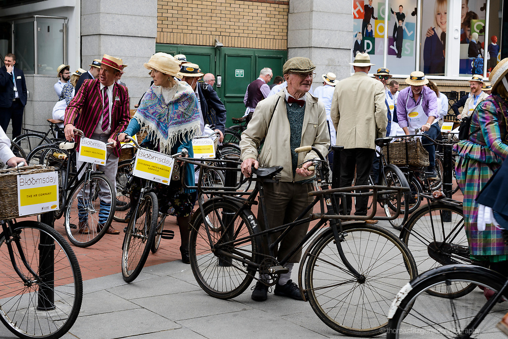 Dublin, Ireland, June 16: 2017 - People gather on old bycycles outside the Stephen's Green centre in a cycle to commomerate Bloomsday, in honour of the novel Ulysees by James Joyce