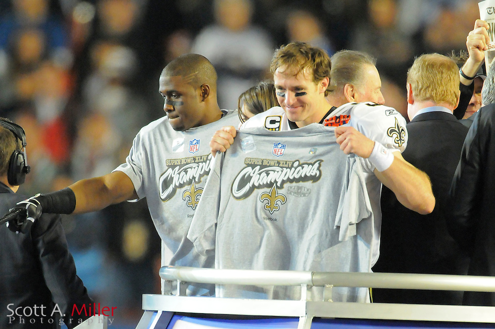 Miami, FL, USA; New Orleans Saints quarterback Drew Brees and running back Reggie Bush celebrate after his team beat the Indianapolis Colts 31-17 in Super Bowl XLIV at Sun Life Stadium on Feb 7, 2010...©2010 Scott A. Miller