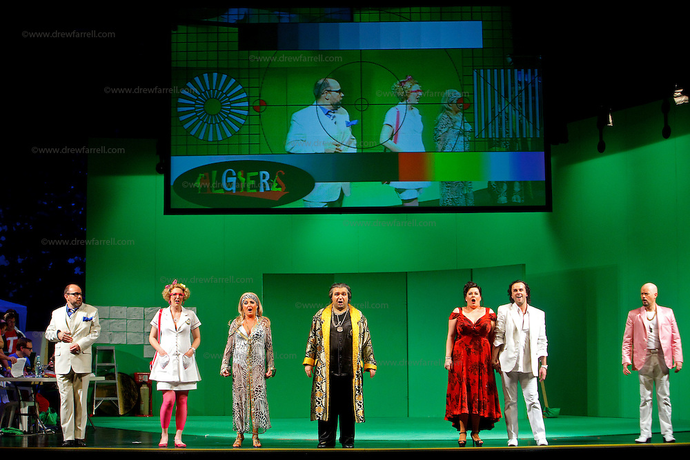 Picture shows : (l-r) Adrian Powter as Taddeo, Julia Riley as Zulma, Mary O'Sullivan as Elvira, Tiziano Bracci as Mustafa, Karen Cargill as Isabella,Thomas Walker as Lindoro  and Paul Carey Jones as Haly..Picture  ©  Drew Farrell Tel : 07721 -735041..A new Scottish Opera production of  Rossini's 'The Italian Girl in Algiers' opens at The Theatre Royal Glasgow on Wednesday 21st October 2009..(Soap) opera as you've never seen it before.Tonight on Algiers.....Colin McColl's cheeky take on Rossini's comic opera is a riot of bunny girls, beach balls, and small screen heroes with big screen egos. Set in a TV studio during the filming of popular Latino soap, Algiers, the show pits Rossini's typically playful and lyrical music against the shoreline shenanigans of cast and crew. You'd think the scandal would be confined to the outrageous storylines, but there's as much action off set as there is on.... .Italian bass Tiziano Bracci makes his UK debut in the role of Mustafa. Scottish mezzo-soprano Karen Cargill, who the Guardian called a 'bright star' for her performance as Rosina in Scottish Opera's 2007 production of The Barber of Seville, sings Isabella. .Cast .Mustafa...Tiziano Bracci.Isabella..Karen Cargill.Lindoro...Thomas Walker.Elvira...Mary O'Sullivan.Zulma...Julia Riley.Haly...Paul Carey Jones.Taddeo...Adrian Powter. .Conductors.Wyn Davies.Derek Clarke (Nov 14). .Director by Colin McColl.Set and Lighting Designer by Tony Rabbit.Costume Designer by Nic Smillie..New co-production with New Zealand Opera.Production supported by.The Scottish Opera Syndicate.Sung in Italian with English supertitles..Performances.Theatre Royal, Glasgow - October 21, 25,29,31..Eden Court, Inverness - November 7. .His Majesty's Theatre, Aberdeen  - November 14..Festival Theatre,Edinburgh - November 21, 25, 27 ...Note to Editors:  This image is free to be used editorially in the promotion of Scottish Opera. Without prejudice ALL other licences without prior consent will be deemed a breach of c