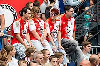 ROTTERDAM - Eerste training van Feyenoord , voetbal , seizoen 2015-2016 , Stadion De Kuip , 28-06-2015 , 4 Feyenoord supports zitten op een hek