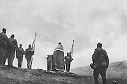 Russian troops attending mass on a mountain top after the reading of the manifesto of the new government, in the Serbian mountains of Macedonia during the First World War, photograph published in L'Illustration no.3875, 9th June 1917. Picture by Manuel Cohen