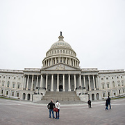 Very wide-angle shot of the US Capitol Building's eastern side on an overcast day.
